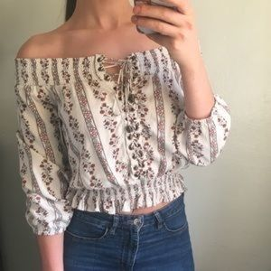 Kittenish off the shoulder lace up top